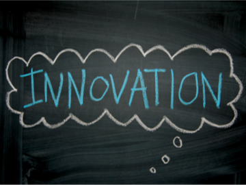 Innovation word written on blackboard in a speech bubble