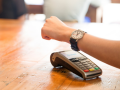 bpay wearable contactless payment device hovering over POS terminal watch
